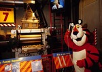 Tony the Tiger listening to exhibit on the making of cereal at Kellogg's Cereal City USA