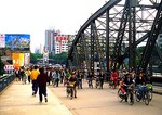 Guangzhou bicycle commuters on Hai Zhu Bridge over Pearl River