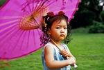 Girl with parasol in Huagang Park on Hangzhou's West Lake