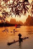 Li River cormorant fishermen on bamboo rafts near Xingping