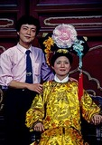 Imperial Palace Museum (Forbidden City) couple posing for photo with woman in imperial costume