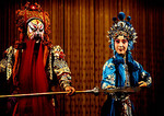 Beijing Opera dan character confronts a villanous jing character in the opera Stealing Silver from the National Bank on stage of the Liyuan Theater