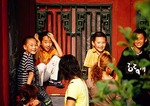 Shenyang Imperial Palace, children playing in corner of courtyard