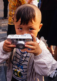 Shenyang Imperial Palace, small boy with camera