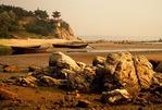 Rocky Beidaihe beach on Bohai Sea at low tide in morning