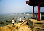Beidiahe retirees watching the fishing boats on Bohai Sea in morning