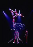 Shanghai Acrobats bicycle balancing act on stage of the Magnolia Theater