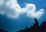 Hong Kong's Po Lin Monastery Giant Buddha silhouette with cloud on Lantau Island