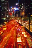 Traffic on Hong Kong's Gloucester Road in Wan Chai at night