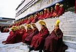 Tibetan monks of the Yellow Hat Sect on steps of Labrang monastery
