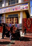 Uighurs at Khotan carpet shop