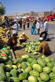 Melon sellers at Khotan Sunday bazaar on the Silk Road
