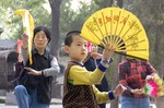 Young boy learning old traditions in park at Small Wild Goose Pagoda