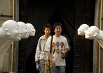 Young art gallery goers and sculpture at Factory 798 Dashanzi Art Zone