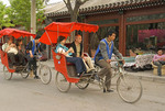 Trishaw tour of hutongs passing through entertainment district along Beijing's back lake, Hou Hai