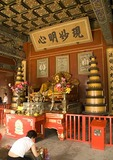 The Lama Temple (Yonghe Gong) interior of a hall with worshipper