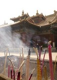 The Lama Temple (Yonghe Gong) with  joss sticks in an incense burner outside the Hall of the Wheel of Law (Falun Dian)