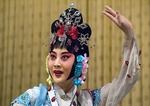 Colorful dancer in Beijing Opera on stage at the Liyuan Theater