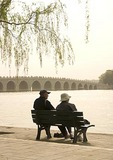 Summer Palace couple on bench near Seventeen Arch Bridge on Kunming Lake