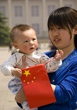 Young mother with child holding PRC flag in Tiananmen Square