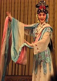 Beijing opera performer on stage at Liyuan Theater
