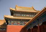 Imperial Palace Museum (Forbidden City) with restored yellow roof tiles and freshly painted details