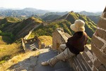 Climber viewing Great Wall from General's Tower at Jinshanling Pass, northeast of Beijing, in Hebei province