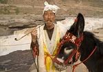 Local Shanxi farmer with his donkey at the Hukou Waterfalls on the Yellow River (Huang He)