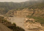 Yellow River (Huang He) down river from Hukou waterfalls on loess plateau, Shanxi province, with Shaanxi on opposite bank
