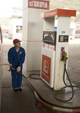 Sinopec gasoline (petrol) filling station with young woman worker at pump in rural Shanxi