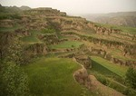 Eroded landscape of loess plateau with terraced farming near Yellow River (Huanghe) in Shanxi province