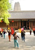 Morning exercise group with fans at Xian's Small Wild Goose Pagoda (Xiaoyan Ta)