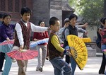 Young boy learning old traditions in park at Xian's Small Wild Goose Pagoda (Xiaoyan Ta)