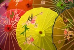 Colorful umbrellas with hand-painted designs for sale in Xian shop