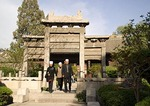 Xi'an's Great Mosque with Hui Muslims entering under Chinese-style stone archway