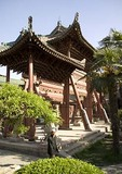 Xi'an's Great Mosque with Hui Muslim entering past Chinese-style wooden archway