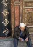 Xi'an's Great Mosque with Hui Muslim man sitting at entrance to prayer hall