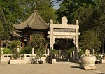 Xi'an's Great Mosque garden courtyard with Chinese-style stone archway and pavilions