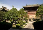 Xi'an's Great Mosque garden courtyard with Chinese-style wooden archway and pavilions