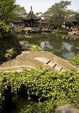 Suzhou's Master of Nets Garden (Wang Shi Yuan) with small stone bridge in foreground