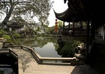 Suzhou's Master of Nets Garden (Wang Shi Yuan) with zig zag bridge in foreground