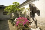 Suzhou's Master of the Nets Garden (Wang Shi Yuan) courtyard landscaping with Taihu stone rockery, bonzai trees, and flowers