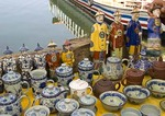 Porcelain figurines and dishware for sale on waterfront of Golden Shuttle Island in Lake Erhai near Dali