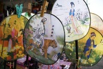 Decorative fans at shop on Golden Shuttle (Jinsuo Dao) Island in Lake Erhai near Dali