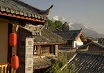 Lijiang's black tiled roofs with Jade Dragon Snow Mountain in background