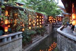 Lijiang Old Town restaurant lanterns in evening along canal
