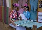Lijiang Old Town Naxi women weavers in cloth shop