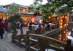 Lijiang Old Town restaurant along canal in evening