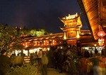 Lijiang Old Town night time activity around the stone bridge in central square