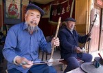 Erhu musicians in Baisha Village near Lijiang